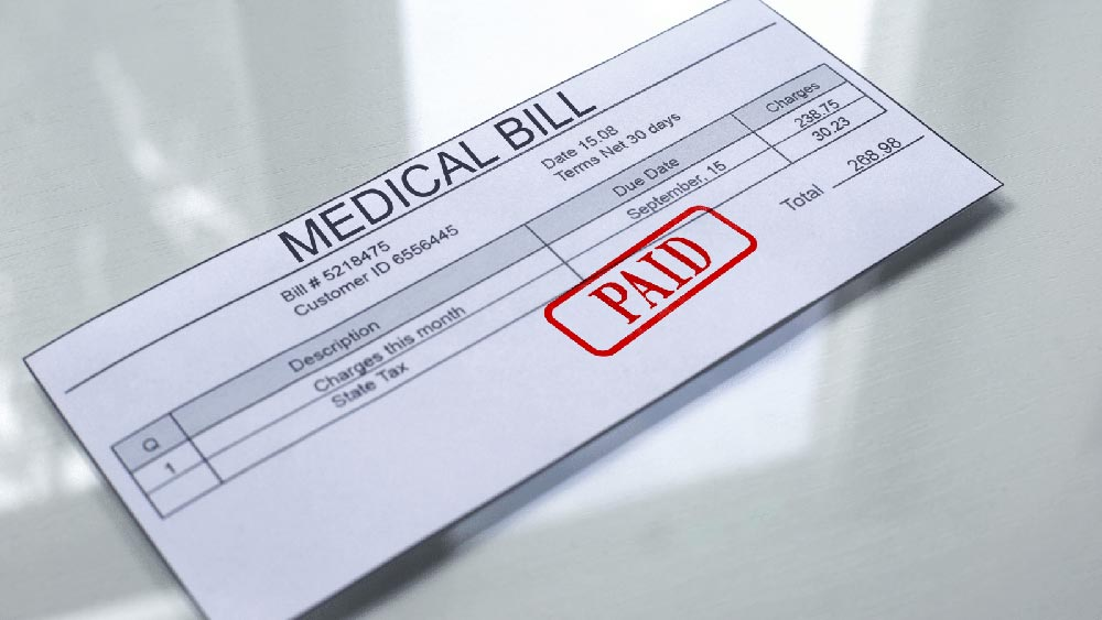 A medical bill marked as paid thanks to Colorado personal injury law that allows people to get compensated fully for their injuries do to accidents where they are not at fault.