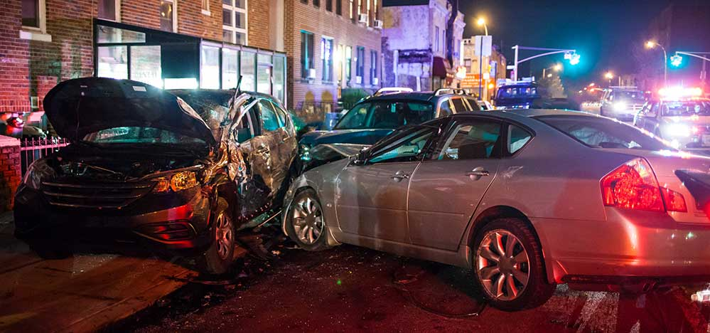 auto accidents are one of the more common types of personal injury cases in Colorado as shown in this photo of an accident in downtown Denver, CO.