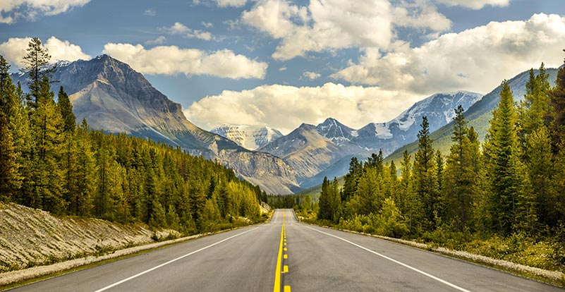 Two lane highway in the Rocky Mountains of Colorado.