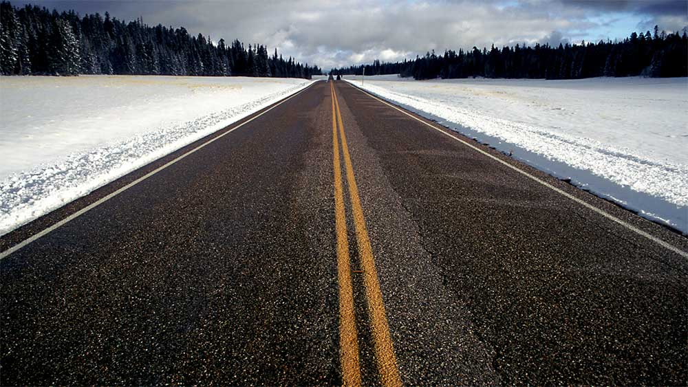 Two lane highway in mountains of Colorado.