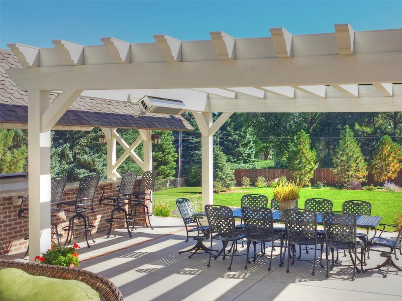 Outdoor living area with pergola, grill, and bar in the Broadmoor.