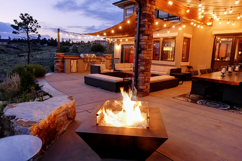 Natural gas fire pit constructed of metal and glass.
