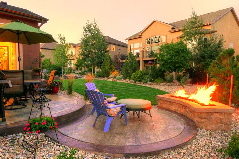 This natural gas fire pit is constructed of manufactured block and is a perfect fit for this smaller patio space.