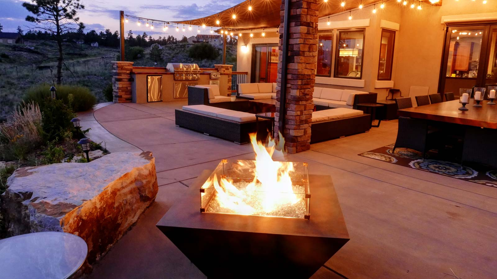 Fire pit designed with outdoor patio