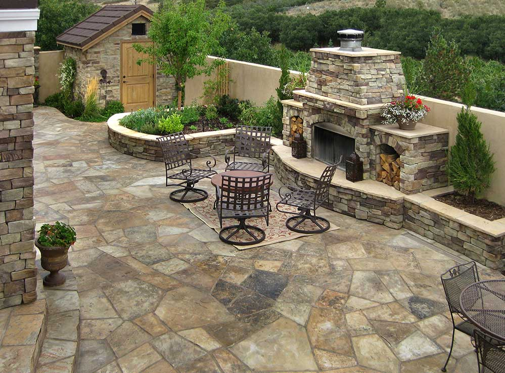 Courtyard with a flagstone patio and a custom wood burning fireplace.