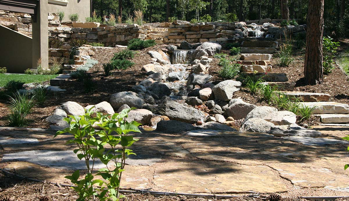 At the base of this water feature is a Siloam stone patio set in road base.