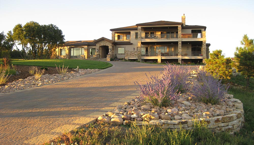 Landscape that utilizes native grass, making even this large landscape very water friendly.