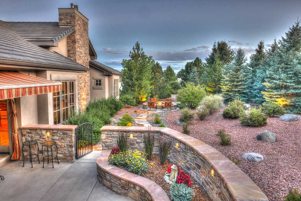 Backyard landscape design with pathway to firepit.