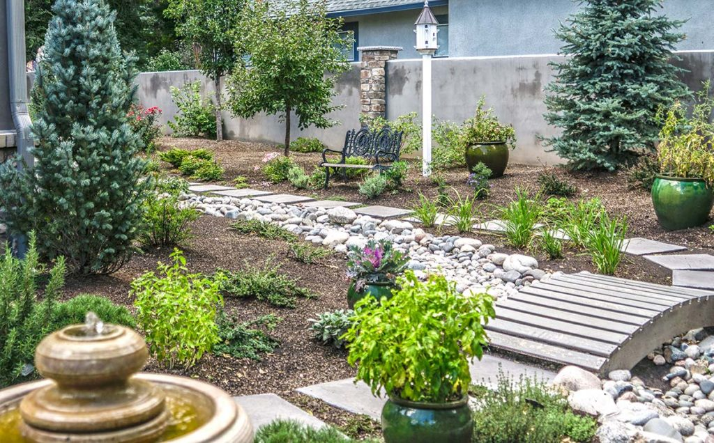 This small space in the Broadmoor uses a number of little accents to create a very enjoyable small garden space.