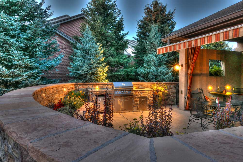 Pation enclosed with stone wall and outdoor grill
