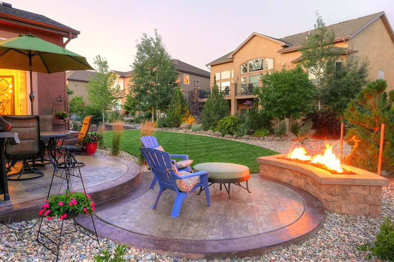 Dense plantings create privacy around this cozy outdoor living space located in Monument.