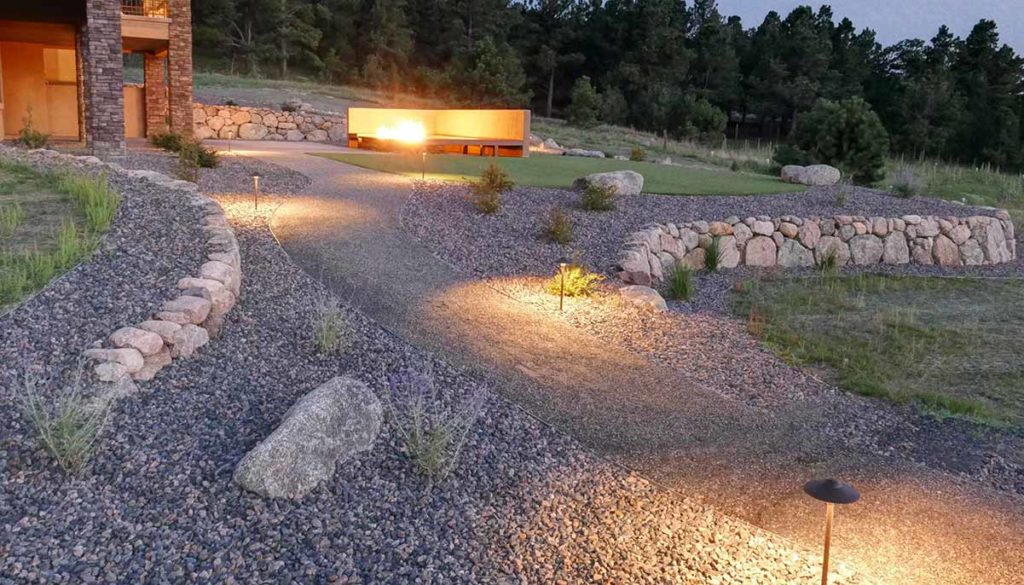 Outdoor lighting on a path to the backyard patio.