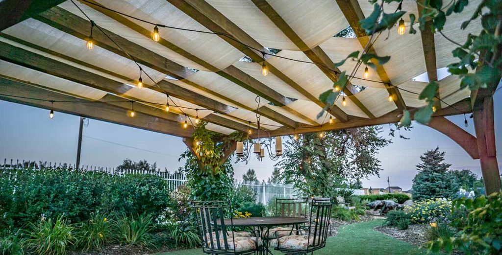These low voltage LED string lights  hang from the trellis and illuminate this outdoor living area while providing their own distinct ambiance.