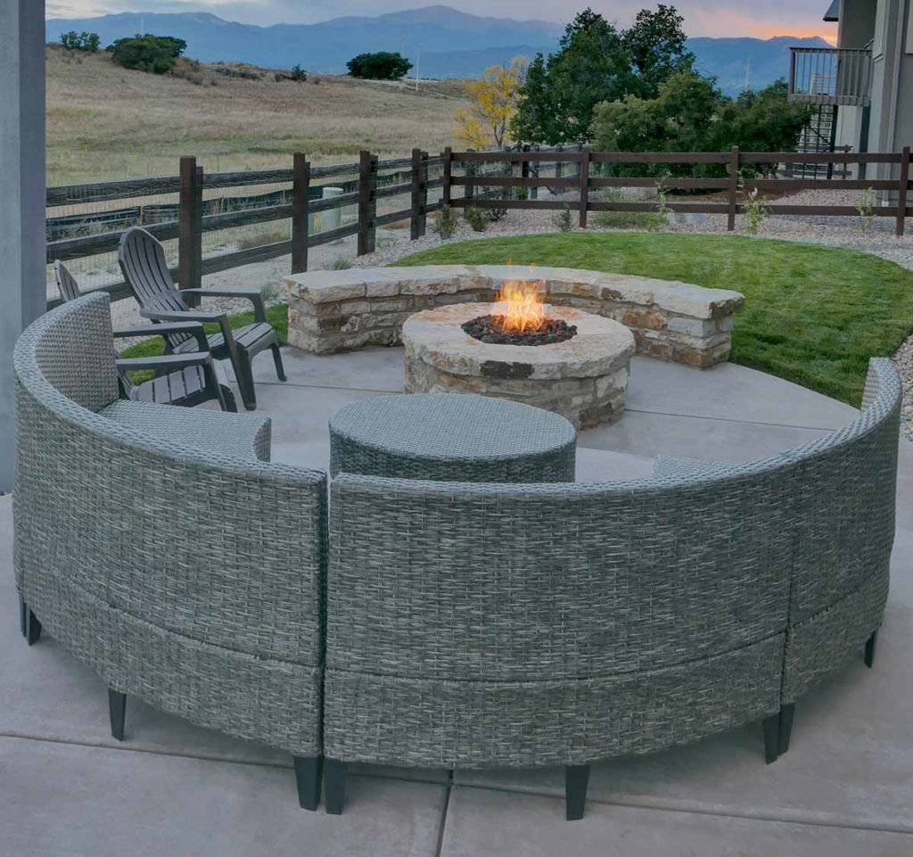 Xeriscaped backyard with fire pit and small area of turf.