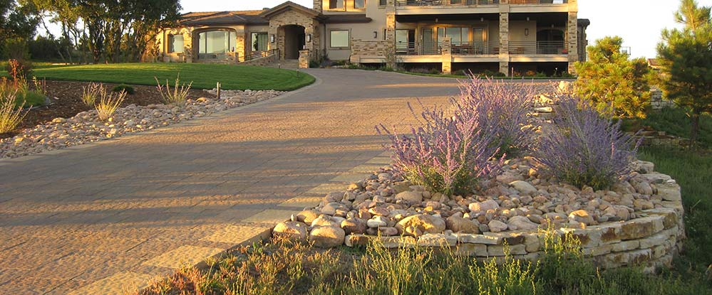 This beautiful paver driveway stands out within this Flying Horse landscape.