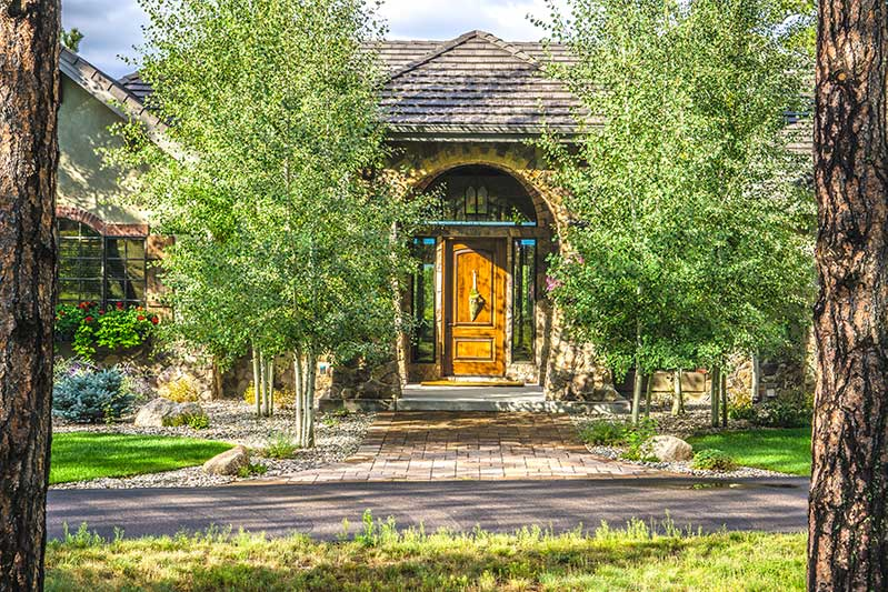 Photo of front entry that shows how to improve curb appeal with landscape design.
