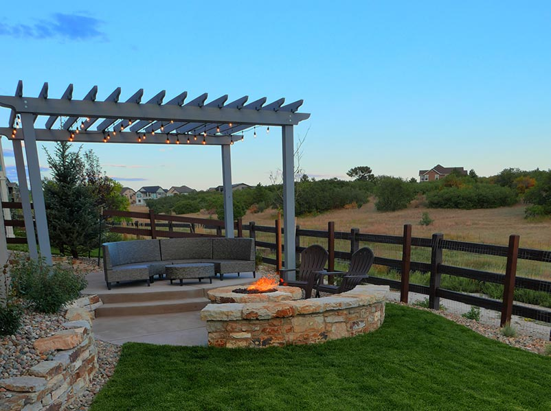 This cedar pergola was stained to match the home beautifully.