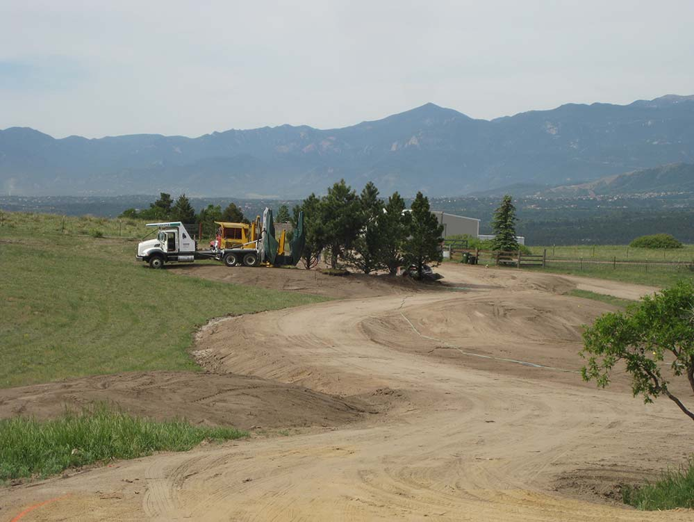 Relocating native Ponderosa pine during Accent Landscapes construction project with tree spade.