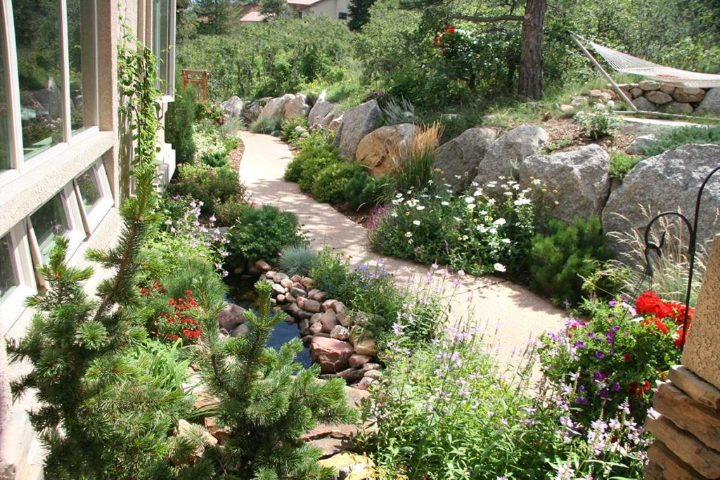 Residential landscape design with a colorful walkway.