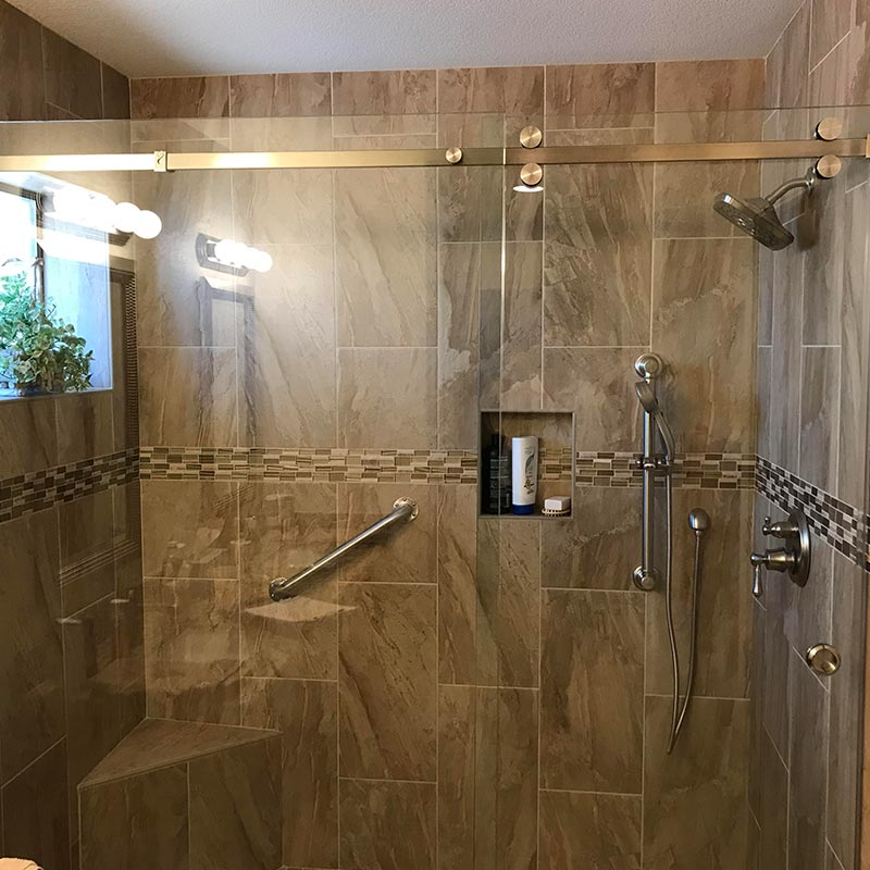bathroom after remodel with glass and tile shower