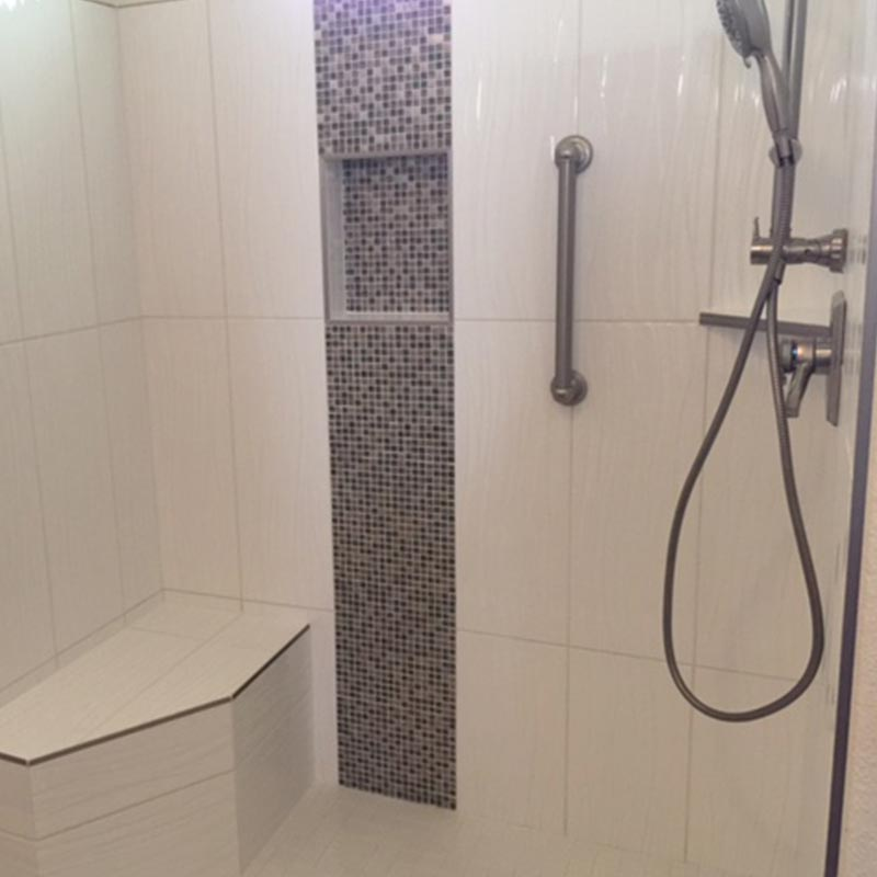 walk-in shower with bench after remodel