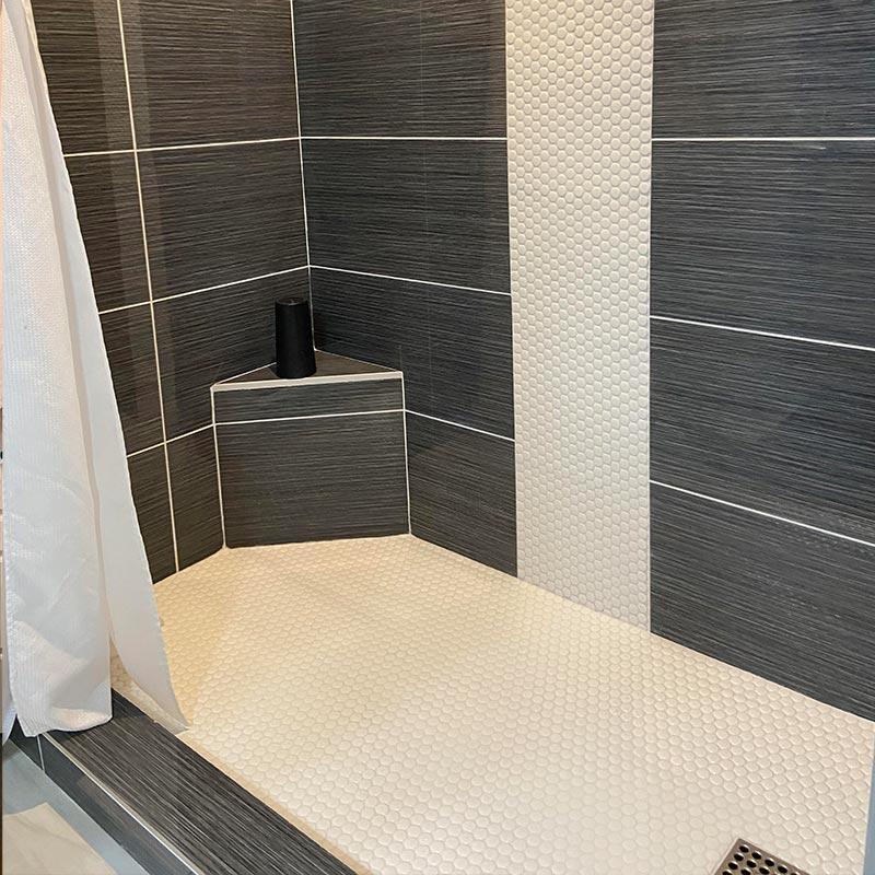 Bathroom after tub converted to walk-in shower