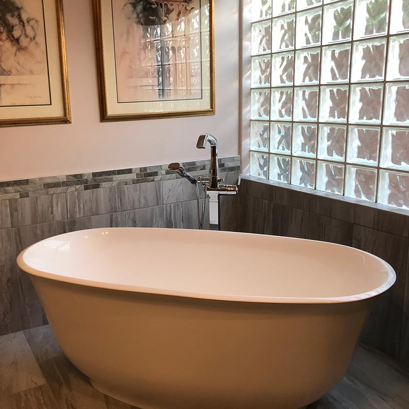 after photo of bathroom remodel with free standing tub