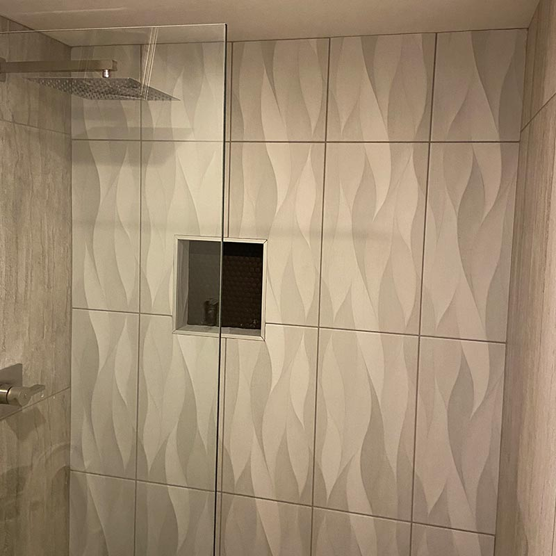 after photo of bathroom remodel with walk in shower
