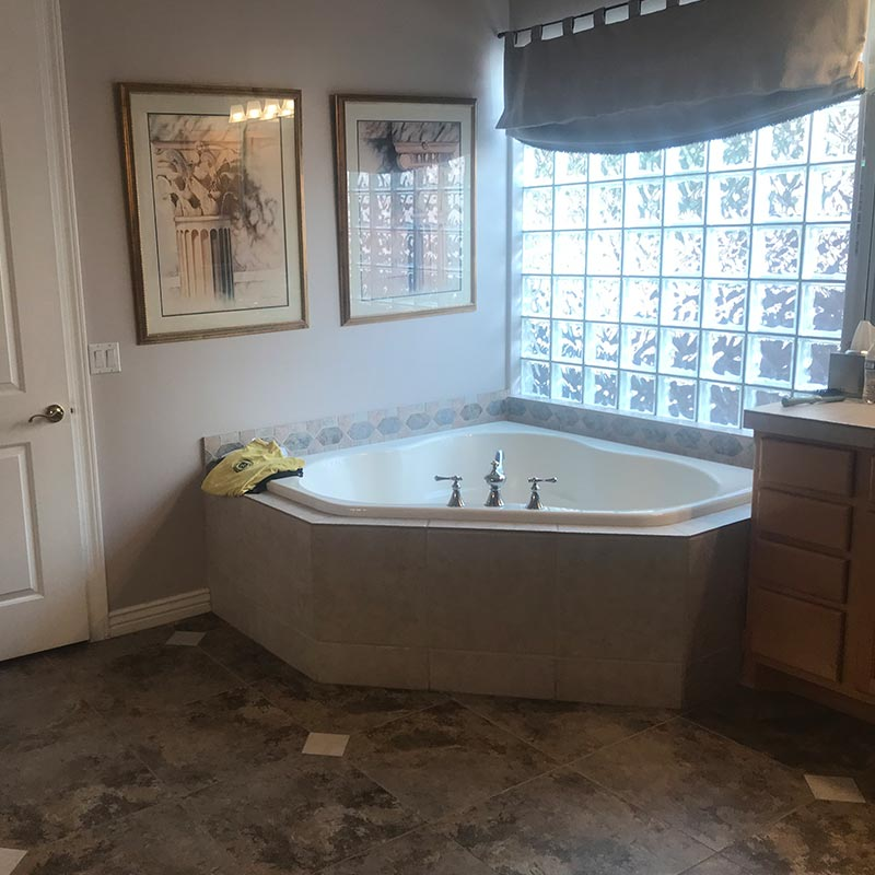 before photo of bathroom remodel with free standing tub